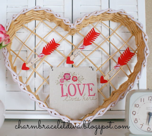 Vintage inspired Valentine's Day vignette with banner and roses