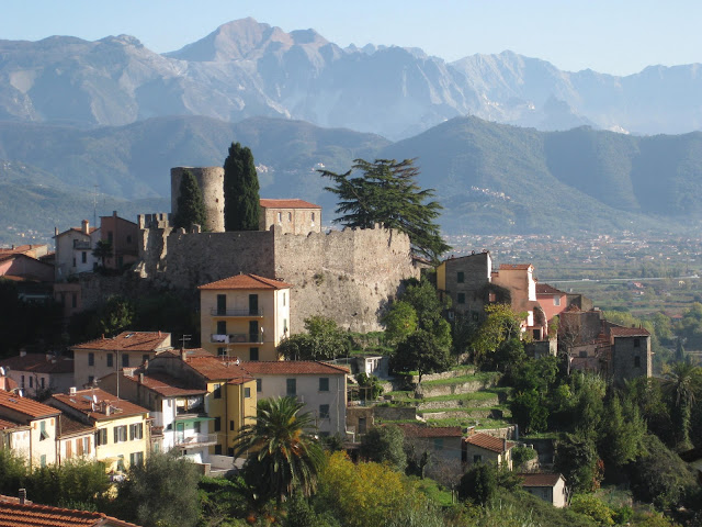 Italian Hill Town of Ameglia with its Castle & the Apuan Alps in Liguria.