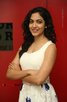 Actress Ritu Varma Stills in White Floral Short Dress at Kesava Movie Success Meet .COM 0058.JPG