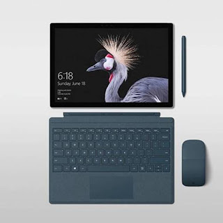 Source: Microsoft. The Surface Pro (top left) together with accessories.