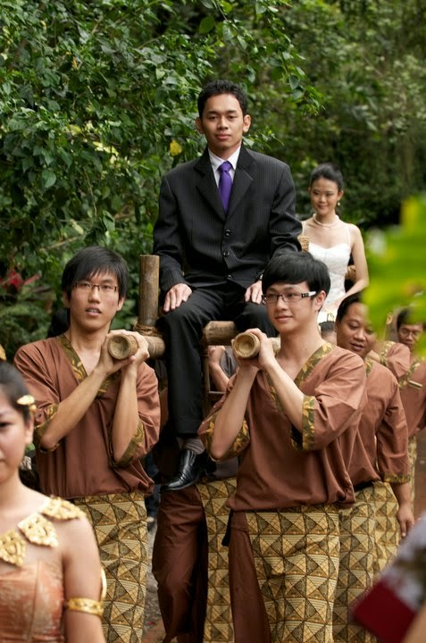 carry bride groom