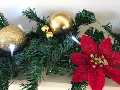 Christmas garland with baubles and poinsettias