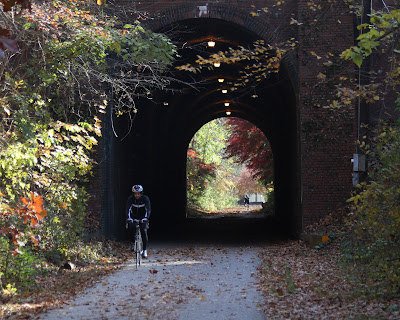 Rider bicycling through tunnel