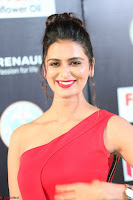 Meenakshi Dixit in Red One Shoulder Red Zipped up gown at IIFA Utsavam Award 23.JPG