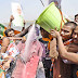 BJP workers played Holi with Prime Minister Narendra Modi's poster by pouring milk in Patna on March 13, 2017.