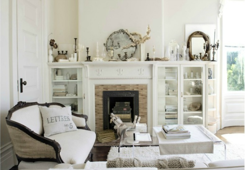 white chic coastal room with silver and glass accessories