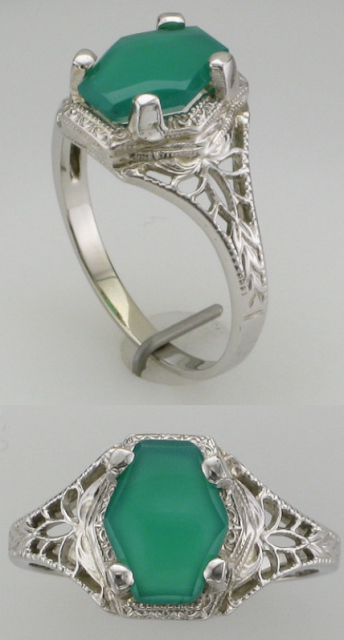 Vintage green onyx and white gold filigree ring from the 1940's. Via Diamonds in the Library.