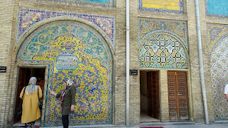 Iranians walk inside the Golestan Palace
