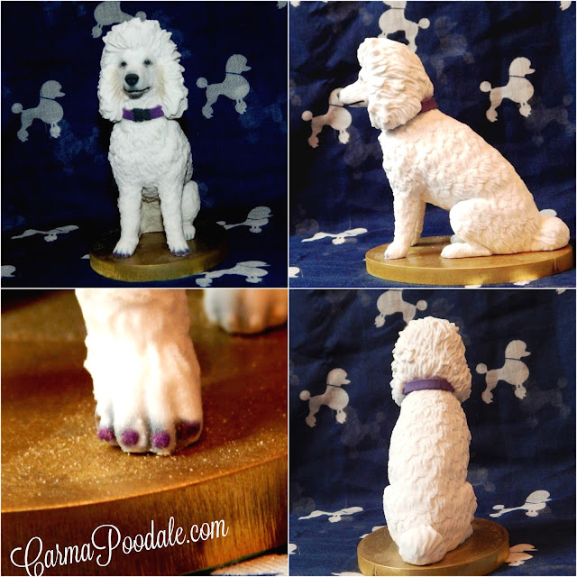 3D white poodle statue. Poodle wearing purple collar with purple nails.