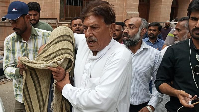 Senior Journalist Nasrullah Khan being taken away from court by CTD Police