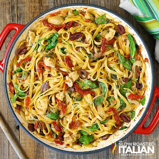 Mediterranean chicken combined with sun dried tomatoes and Greek olives over pasta