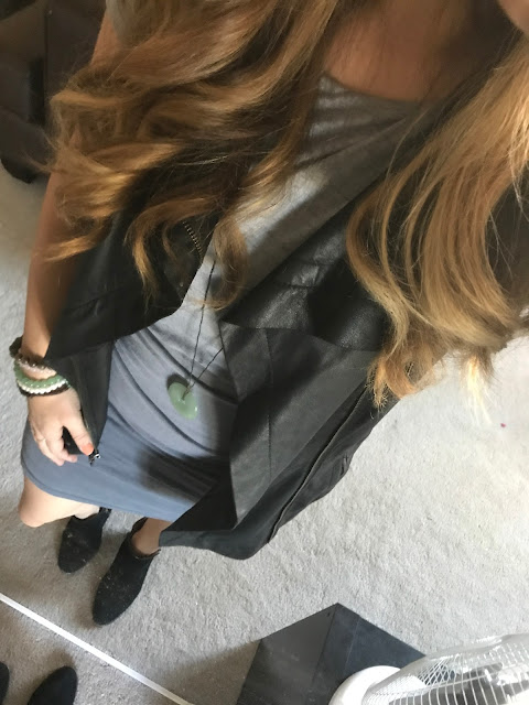 Blue Dress with a Black Leather Vest with Booties and Stone Bracelets