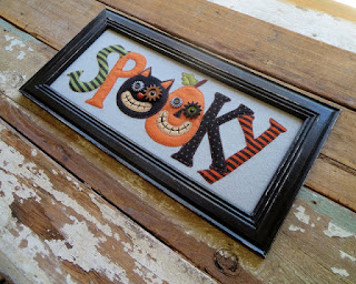 https://squareup.com/market/nestinteriors/item/framed-halloween-spooky-sign-1