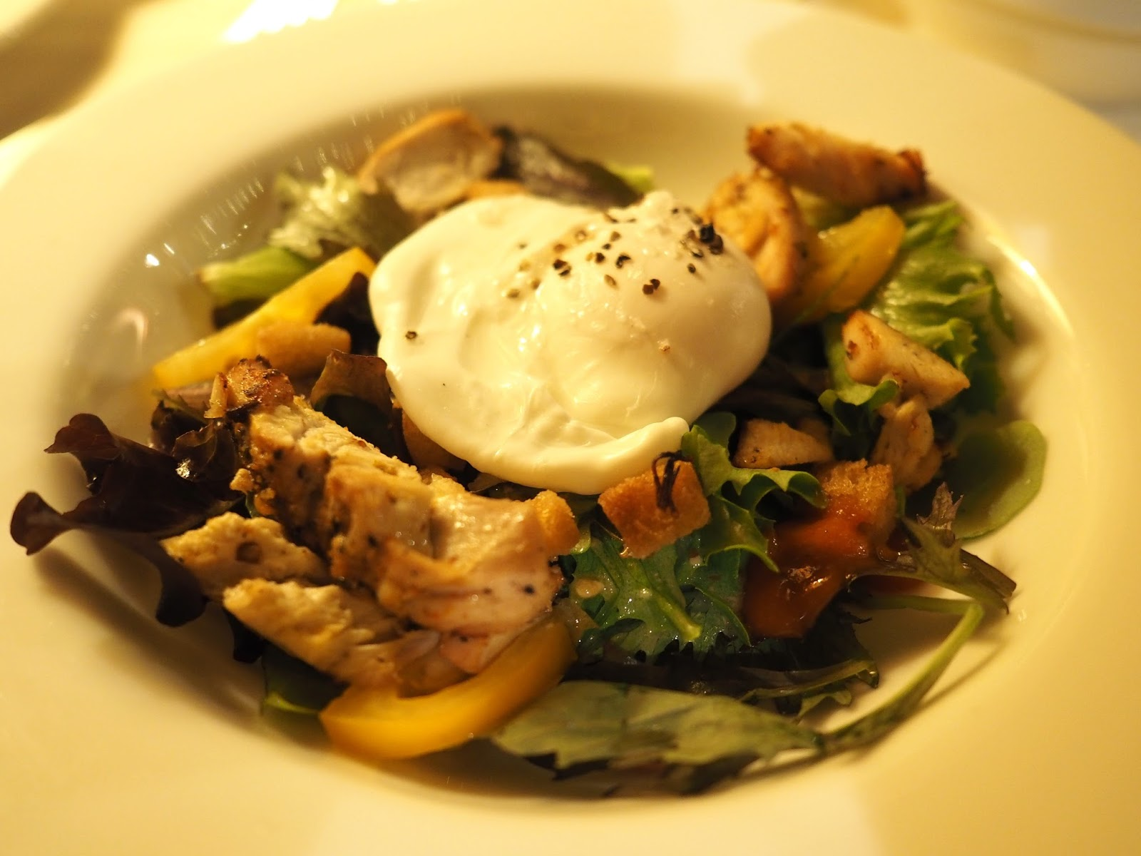 Spicy chicken, dressed salad and poached egg at Le Caveau, excellent French restaurant in Skipton, North Yorkshire