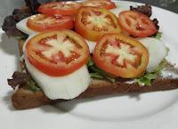 Cucumber tomato slice over lettuce mayonnaise bread for veg club sandwich recipe