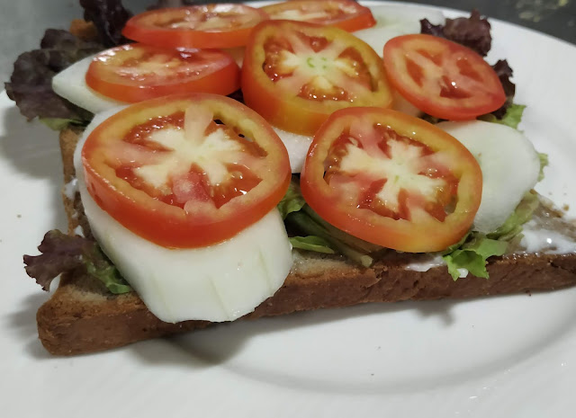 Cucumber tomato slice over lettuce mayonnaise bread for veg club sandwich recipe