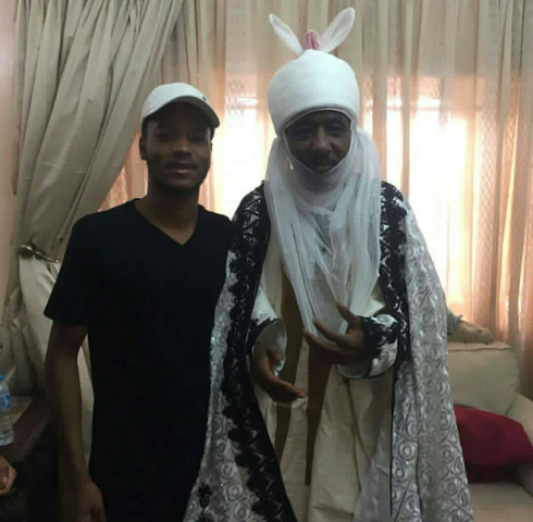 Photo of Emir of Kano Mohammed  Sanusi with one of his sons