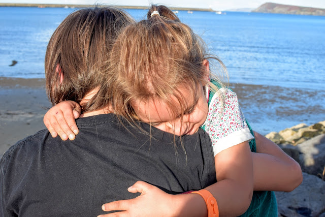 siblings, sibling love, hug, cuddle, Goodwick, Pembrokeshire, Goodwick Parrog, The Parrog, Goodwick Sands Beach, Fishguard, breakwater, coastal town, harbour, village, park, play park, free family day out, day out, fun day out,