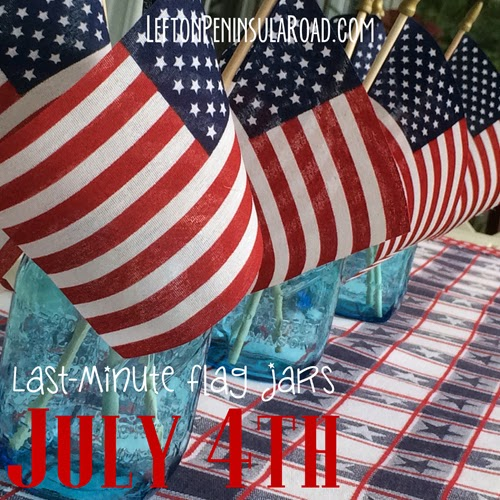 Pair blue mason jars and flags for easy summer table decor.