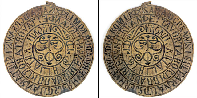 Image showing a circular wooden bread stamp from Iceland with inscription, dated 1876