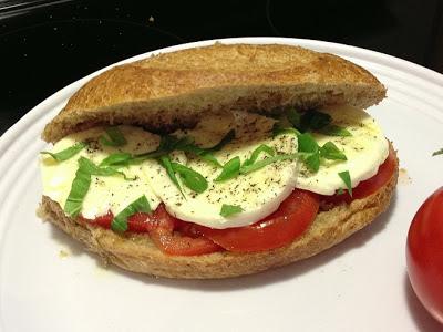 making a caprese sandwich
