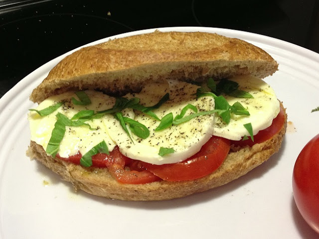 making a caprese sandwich