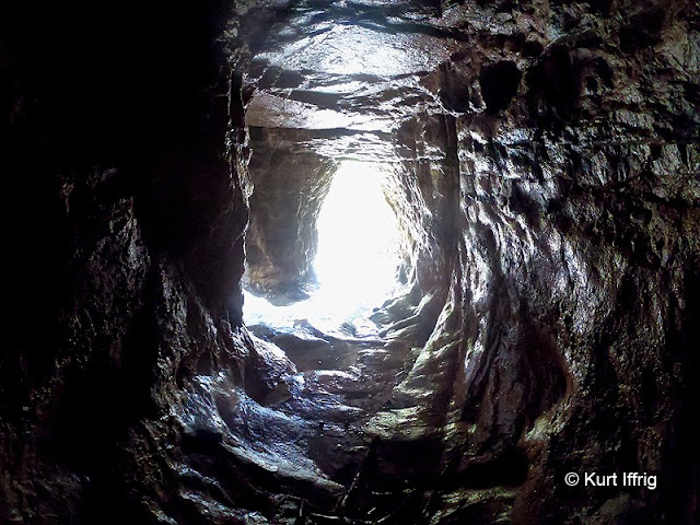 A view from inside the mine. To the left there is a small side tunnel.
