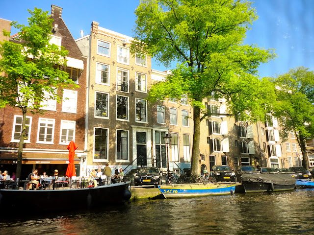 Boats and buildings from the canals of Amsterdam | Netherlands, Europe