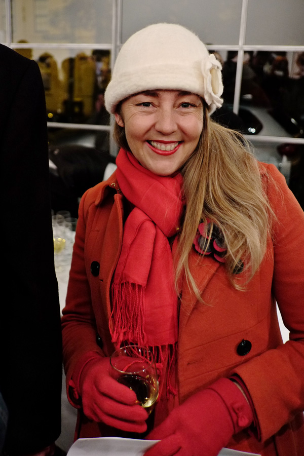 Red wool coat, scarf and gloves with wool cream colour felt cloche. Street Fashion Sydney - Photographed by Kent Johnson.