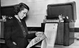 woman using fax machine