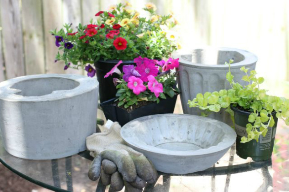 over on ehow diy cement flower pots 17 apart. Black Bedroom Furniture Sets. Home Design Ideas