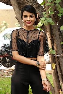 Ashna Zaveri Spicy Cute Slim Beauty in Black Transparent Net Top and Black Trousers at Nagesh Thiraiyarangam press meet