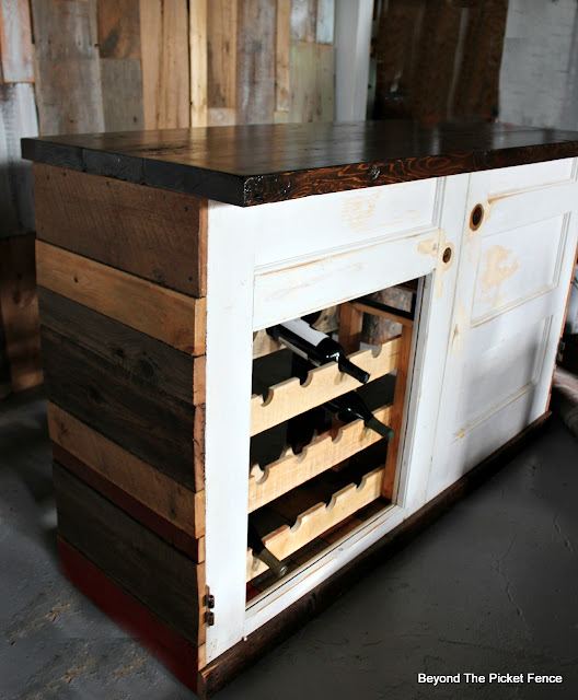old door, bar, rustic, barnwood, repurposed, wine rack, salvaged, DIY, http://bec4-beyondthepicketfence.blogspot.com/2016/03/rustic-old-door-bar-diy.html