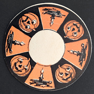 An example of a vintage die cut by Beistle with candles and jack o'lanterns. Front.
