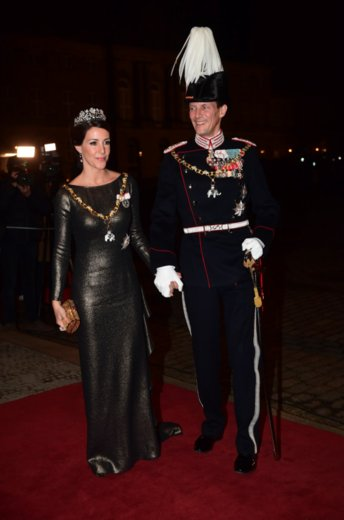 Crown Prince Frederik, Crown Princess Mary, Prince Jaochim and Princess Marie attend New Year's Banquet at Amalienborg Palace. Crown Princess Mary diamon tiara, Princess Marie diamond tiara, diamond earrings, Princess Mary wore diamond earrings wore satin govn and cape