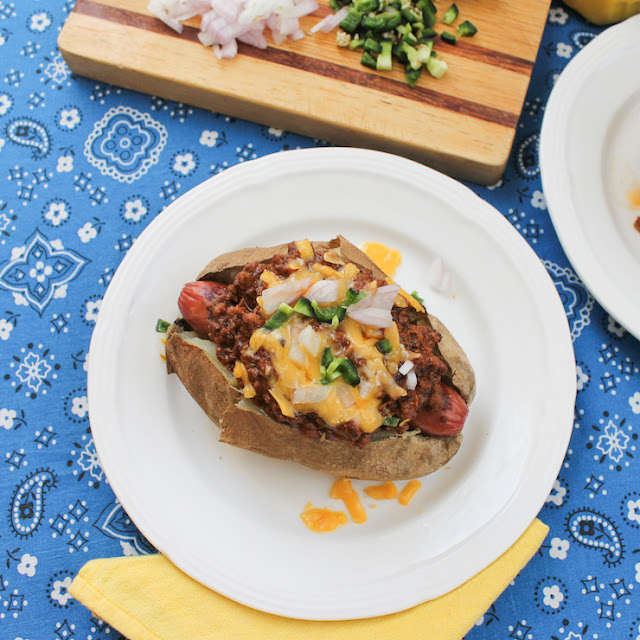 Food Lust People Love: Ban the bun and pass the potatoes! These chili cheese dog baked potatoes will be a favorite at your next family dinner or barbecue.