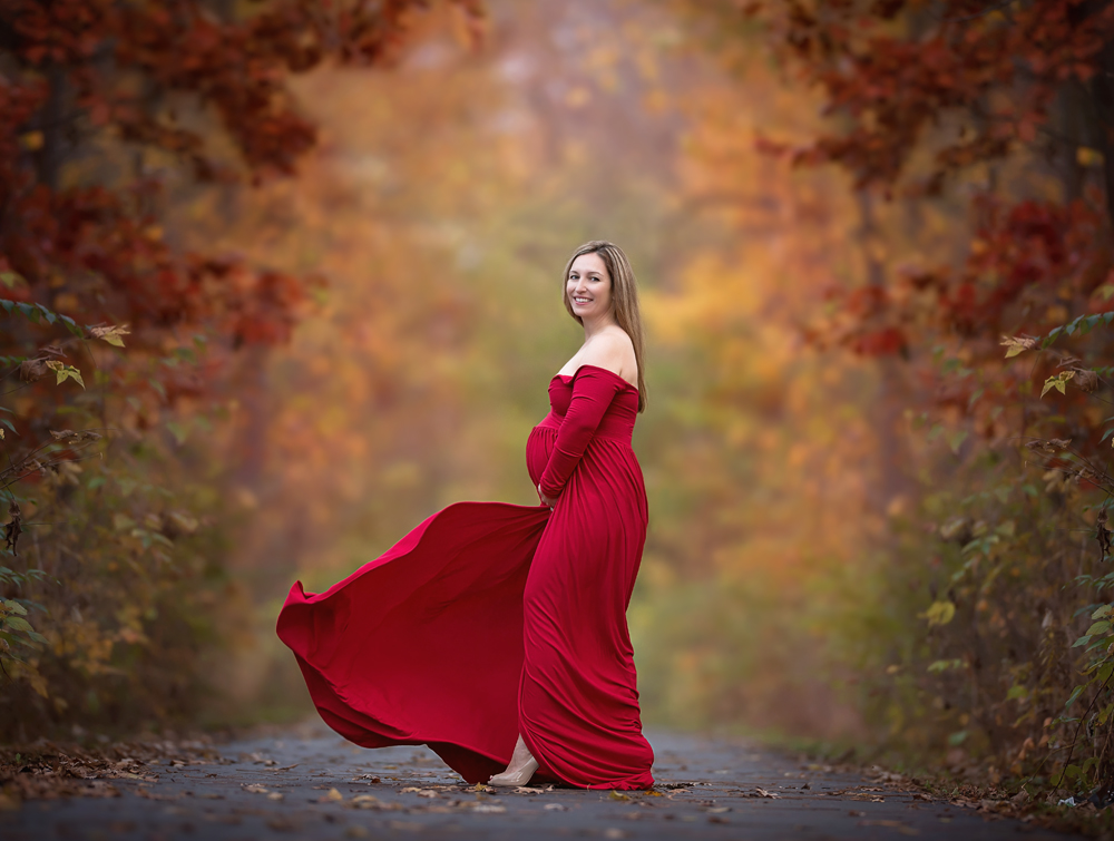 Outdoor maternity fall session in stunning red dress