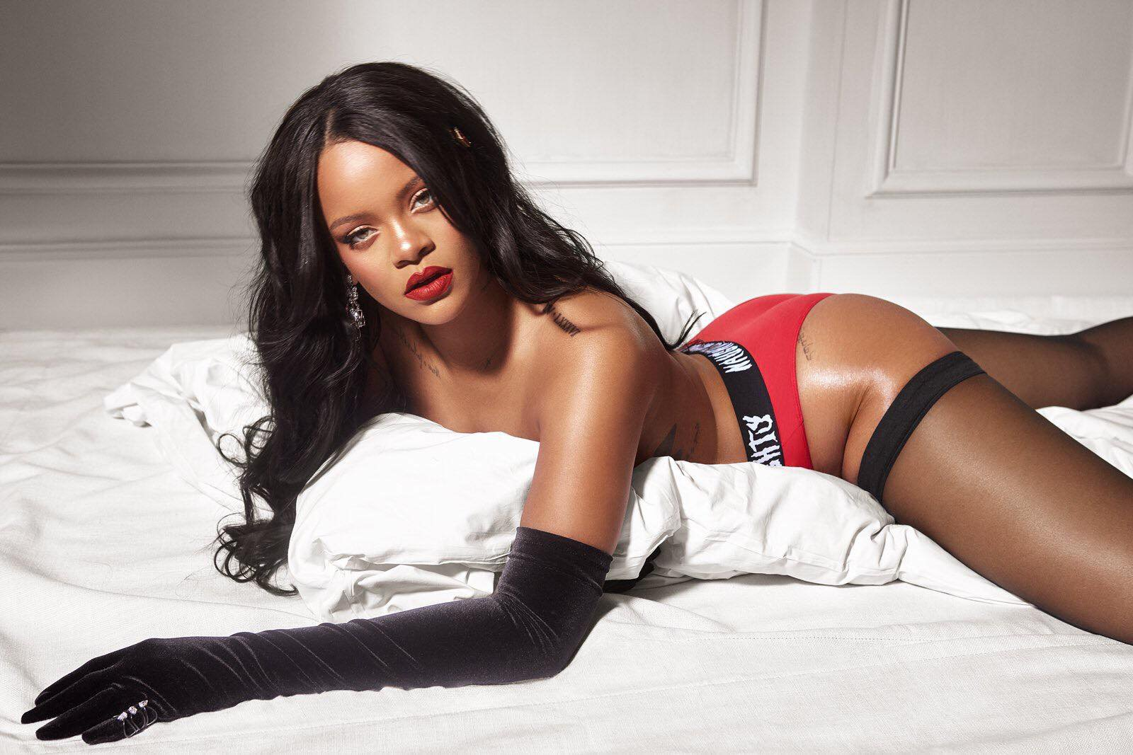 Rihanna sets pulses racing as she poses topless in bed to promote new Fenty and Savage lingerie collaboration