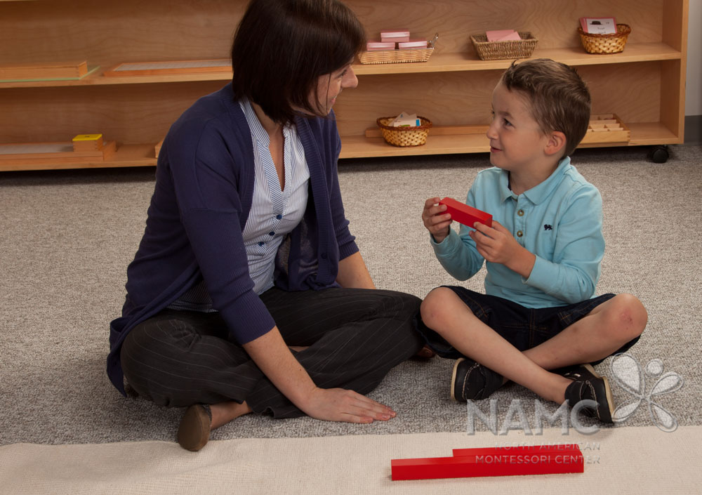 namc studying montessori today lillard ch 2 primary years. boy and teacher using red rods material