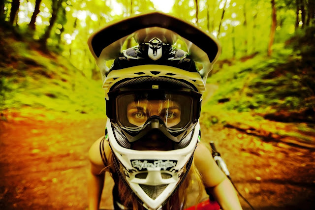 Girl in goggles and a off-road helmet