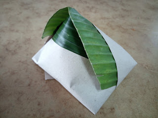 Nasi Lemak bungkus in banana leaf
