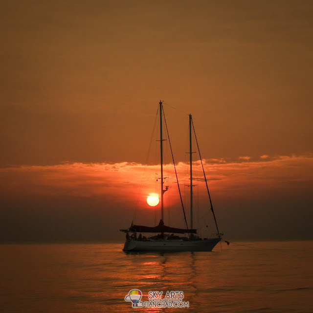 Sunrise near the one and only sailboat on the sea in Club Med Cherating