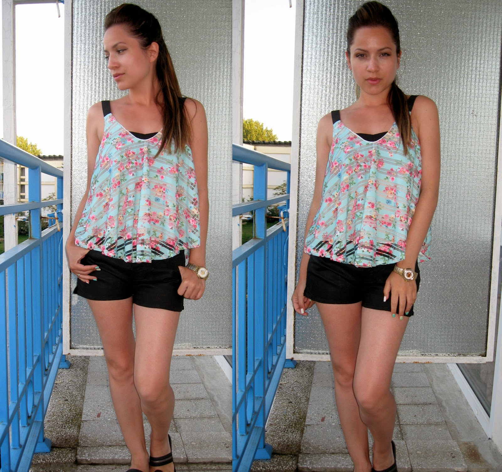 mint top with pink floral print, short black shorts,