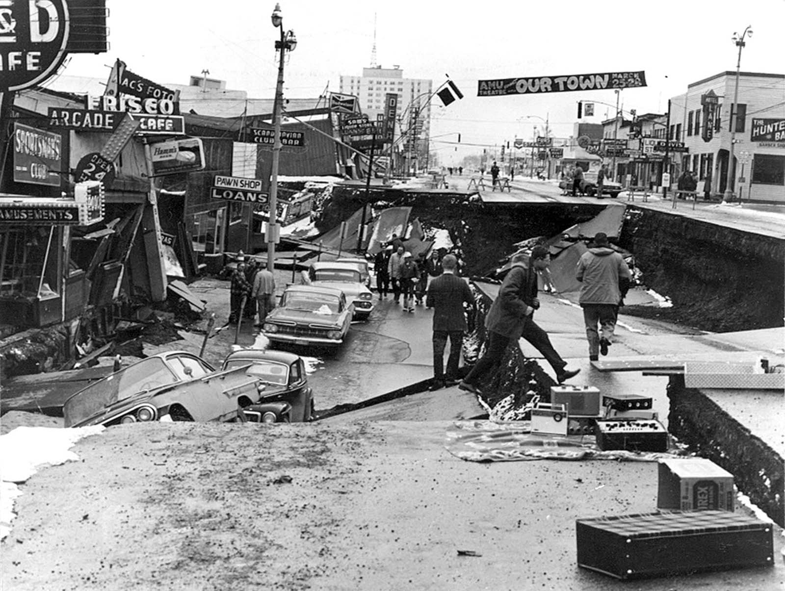 Downtown Anchorage, the collapse of Fourth Avenue near C Street, due to a landslide caused by the earthquake. Before the shock, the sidewalk on the left was at street level with the one on the right.