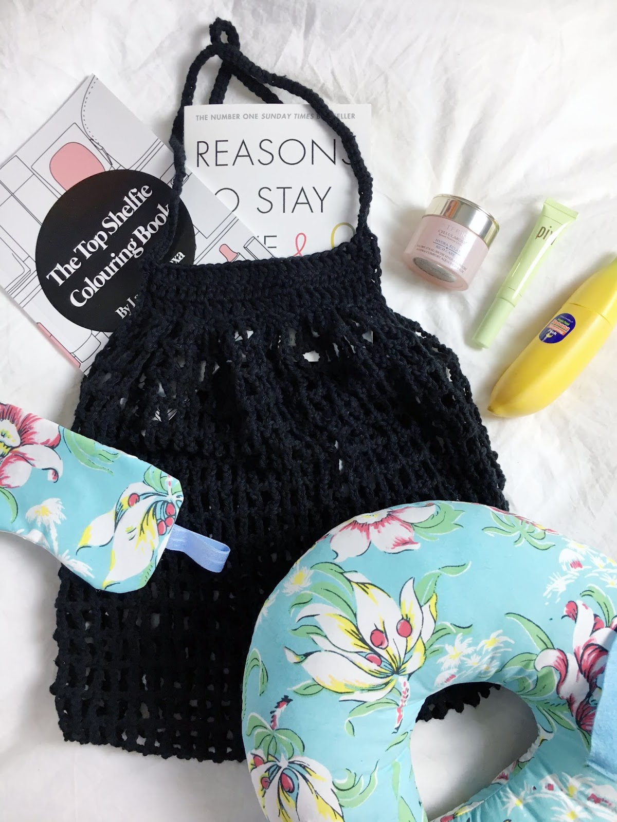 flat lay of what to take in your carry on hand luggage