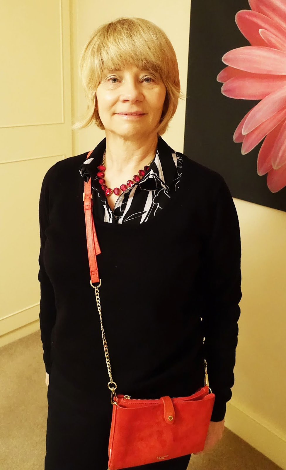 Red and black: red accessories add some wow to a black and white blouse, black jumper and black trousers worn by over-50s blogger Is This Mutton?