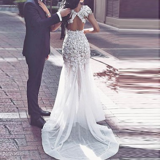 https://www.dressywomen.com/mermaid-open-back-prom-dress-jewel-cap-sleeves-illusion-sweep-train-with-appliques-beading.html