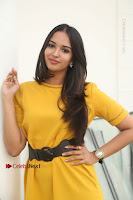 Actress Poojitha Stills in Yellow Short Dress at Darshakudu Movie Teaser Launch .COM 0140.JPG