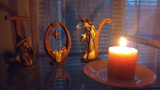 Photo of candle and Christmas Joy display