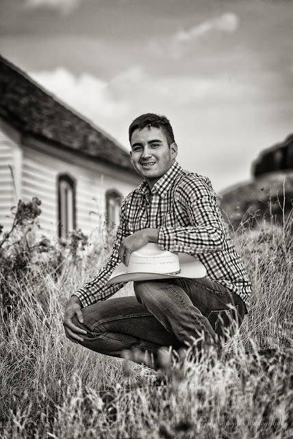 stunning black and white photo of a young man for his senior portrait session in Golden Colorado